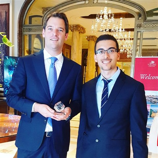 Shahar Ashkenazi (right) and a representative of the Athenee Palace Hilton Hotel, Bucharest